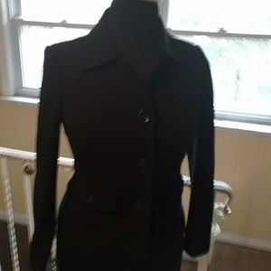 Black jacket with front faux pockets.